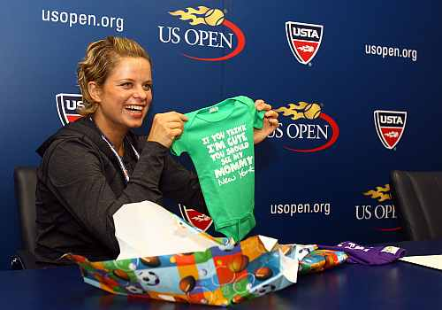 Kim Clijsters of Belgium opens gifts from members of the Belgian media