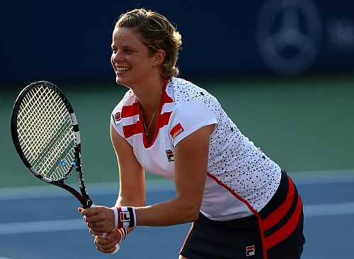 Kim Clijsters of Belgium reacts during a first round mixed doubles match with her partner Bob Bryan