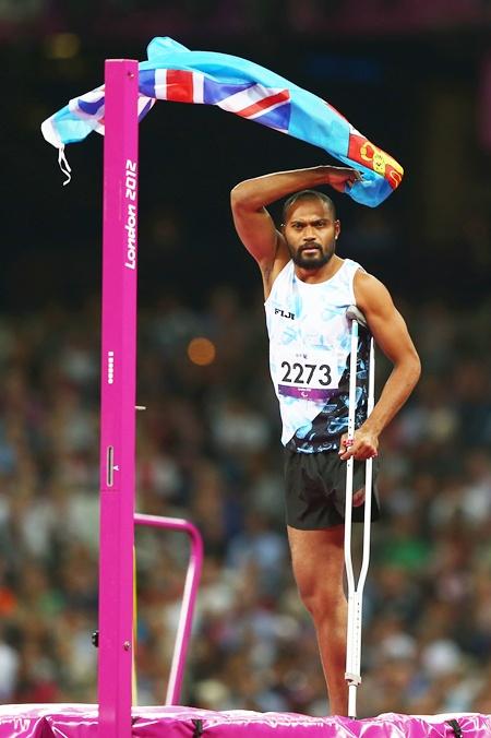 Iliesa Delana of Fiji celebrates winning gold