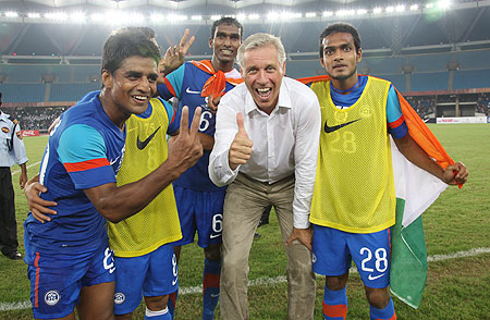 Indian players celebrate with coach Wim Koevermans after winning the Nehru Cup on Sunday