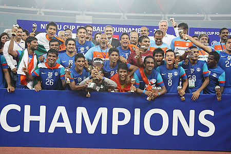 Indian players celebrate after winning the Nehru Cup on Sunday