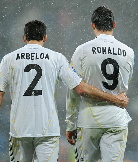 Real Madrid'S Alvaro Arbeloa with teammate Cristiano Ronaldo