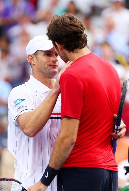 Andy Roddick of the United States shakes hands with Juan Martin Del Potro of Argentina