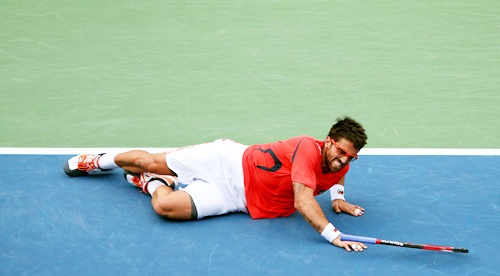 Janko Tipsarevic of Serbia slips on the court
