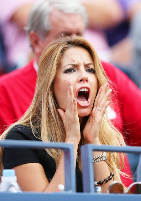 Biljana Sesevic shouts as she watches her husband Janko Tipsarevic