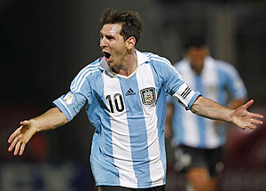 Argentina's Lionel Messi celebrates after scoring their third goal against Paraguay on Friday