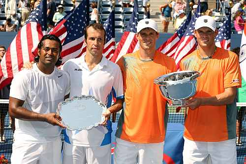 Bob Bryan (R) and Mike Bryan pose with the trophy next to Leander Paes and Radek Stepanek after their men's doubles final match of the 2012 US Open