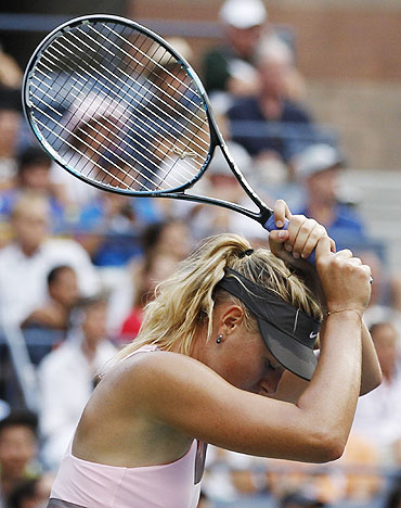 Maria Sharapova reacts after a missed point against Victoria Azarenka