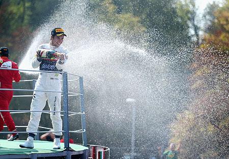 Sergio Perez of Sauber F1 celebrates on the podium after finishing second during the Italian Formula One Grand Prix on Sunday