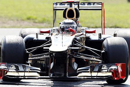 Lotus Formula One driver Kimi Raikkonen steers his car