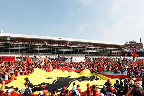 Ferrari fans unfurl a giant Prancing Horse flag on the track