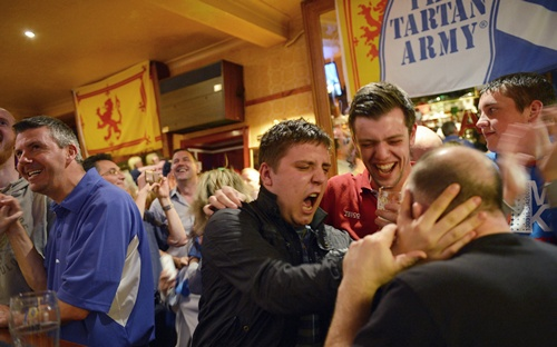 Fans of tennis player Andy Murray react as he wins