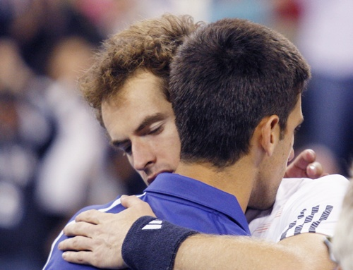 Britain's Andy Murray embraces Serbia's Novak Djokovic
