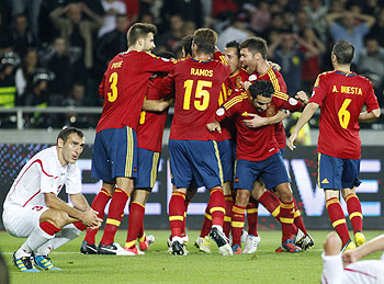 Spain's players celebrate a goal during their 2014 World Cup qualifier against Georgia at Boris Paichadze Stadium in Tbilisi on Tuesday