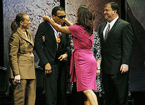 Boxing great Muhammad Ali (centre) is awarded the Liberty Medal by his daughter Laila (right), as his wife Lonnie looks on, at the National Constitution Center in Philadelphia, Pennsylvania, on Thursday