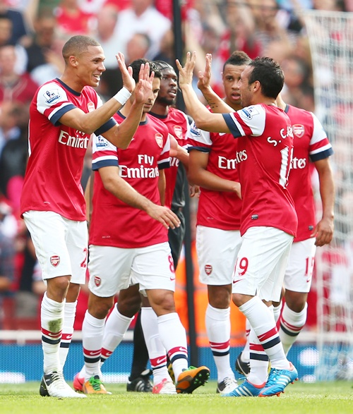 Kieran Gibbs and Santi Cazorla of Arsenal celebrate