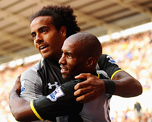 Tottenham Hotspur's Jermain Defoe (right) celebrates with Tom Huddlestone after scoring his second goal against Reading on Sunday