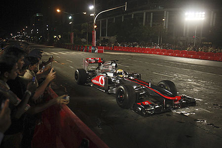 McLaren Formula One driver Lewis Hamilton drives his F1 car on the BKC stretch in Mumbai on Sunday