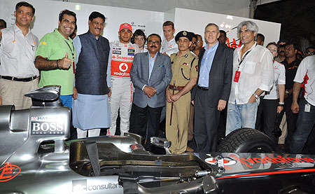 McLaren's Lewis Hamilton (centre) is flanked by Chief Minister of Maharashtra Prithiviraj Chavan, PWD Minister Chaggan Bhujbal, Satyapal Singh, Commissioner of Mumbai Police and Marten Pieters, CEO, Vodafone India (2nd from right) at a promotional event in Mumbai on Sunday