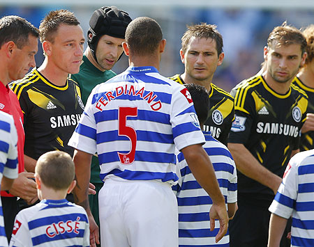 Anton Ferdinand of Queens Park Rangers walks past John Terry of Chelsea without shaking his hand before the start of their English Premier League soccer match at Loftus Road in London on Saturday