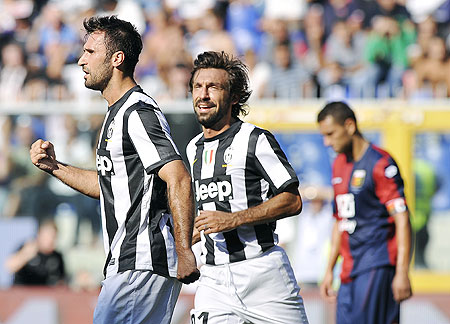 Juventus' Mirko Vucinic (left) celebrates with teammate Andrea Pirlo after scoring against Genoa on Sunday