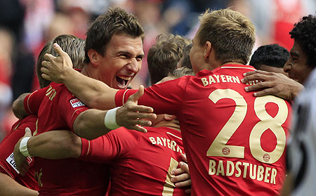 Bayern Munich's Mario Mandzukic (left) celebrates with teammates after scoring against FSV Mainz 05 during their Bundesliga match in Munich on Saturday