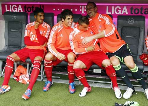 FC Bayern Munich's new midfielder Javi Martinez (second left) sits on the substitute bench