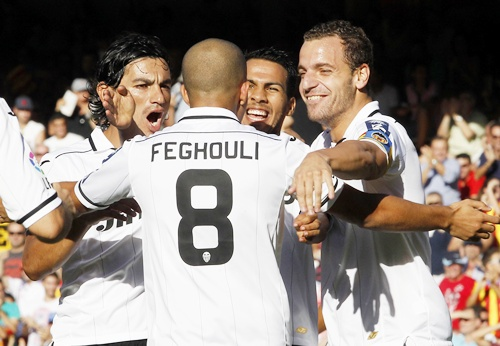 Valencia's Sofiane Feghouli celebrates with teammates