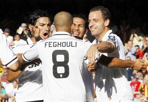 Valencia's Sofiane Feghouli celebrates with teammates