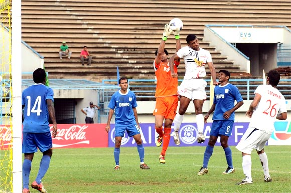 Pronoy Halder  of Pailan Arrows (3rd right) heads the ball as Dempo goalkeeper Subhashish Roy Chowdhury tries to catch