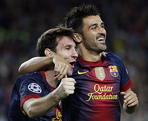 Barcelona's Lionel Messi (left) is congratulated by teammate David Villa after scoring his second goal against Spartak Moscow on Wednesday