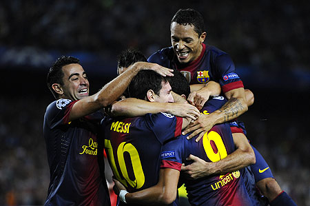 Lionel Messi of FC Barcelona (centre) celebrates with his teammates after scoring the winner against FC Spartak Moscow on Wednesday