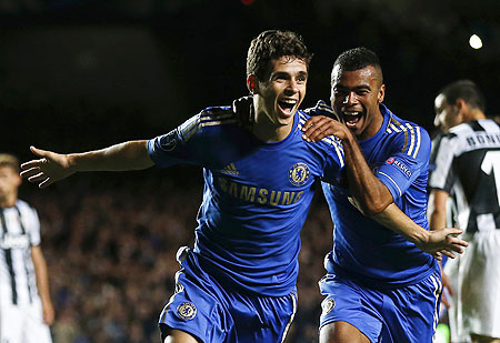 Chelsea's Oscar (left) celebrates with teammate Ashley Cole after scoring against Juventus