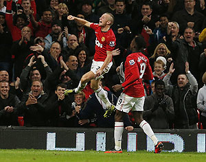 Manchester United's Tom Cleverley (left) celebrates after scoring against Newcastle United during their League Cup match on Wednesday