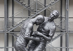 A statue prepared by artist Adel Abdessemed, depicting former French national soccer team player Zinedine Zidane's (left) head-butting Italian defender Marco Materazzi during the 2006 World Cup final, is seen in front of the Centre Pompidou modern art museum in Paris
