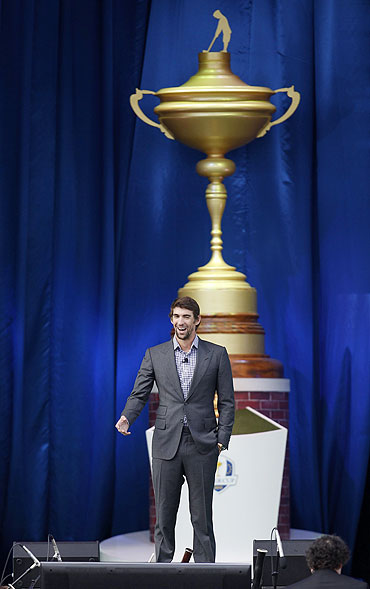 U.S. Olympian Michael Phelps speaks at the start of the opening ceremony for the 39th Ryder Cup golf matches at the Medinah Country Club in Medinah, Illinois