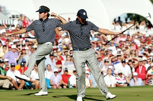 Webb Simpson (right) and Bubba Watson of the USA celebrate