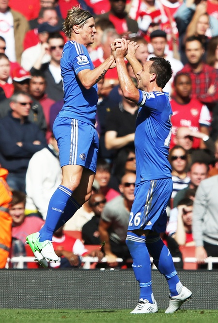Chelsea's Fernando Torres celebrates scoring the first goal of the match with   teammate John Terry