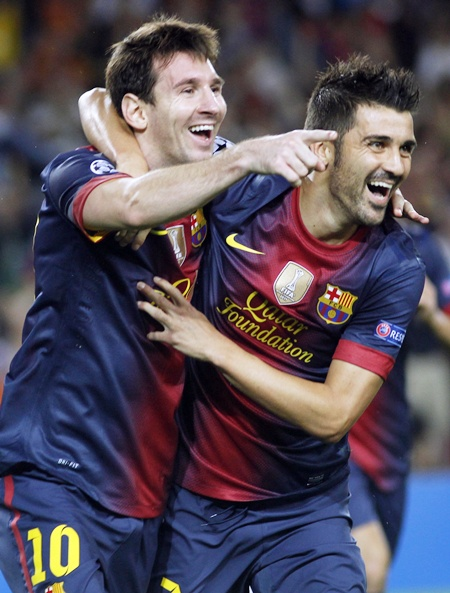 Barcelona's David Villa (right) is congratulated by Messi