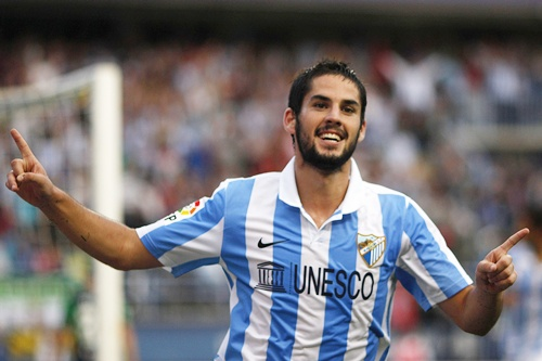 Malaga's Isco celebrates after scoring