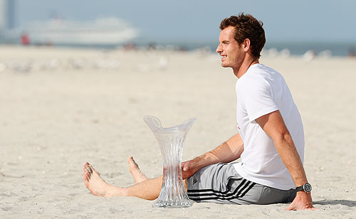 Andy Murray with the Miami Masters trophy on the beach after his three set victory over David Ferrer in Key Biscayne, Florida on Sunday