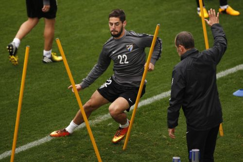 Malaga's Isco runs during a training session
