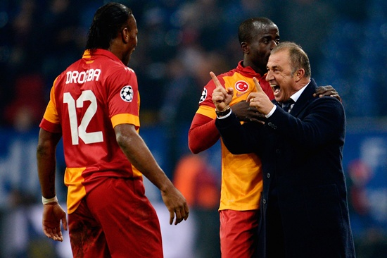 Head coach Fatih Terim of Galatasaray celebrates with Didier Drogba and Dany Nounkeu