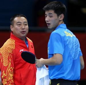 Zhang Jike (right) of China talks with coach Liu Guoliang