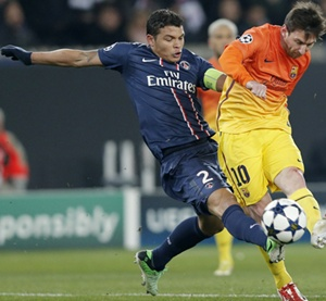 Paris St Germain's Alex (left) challenges Barcelona's Lionnel Messi