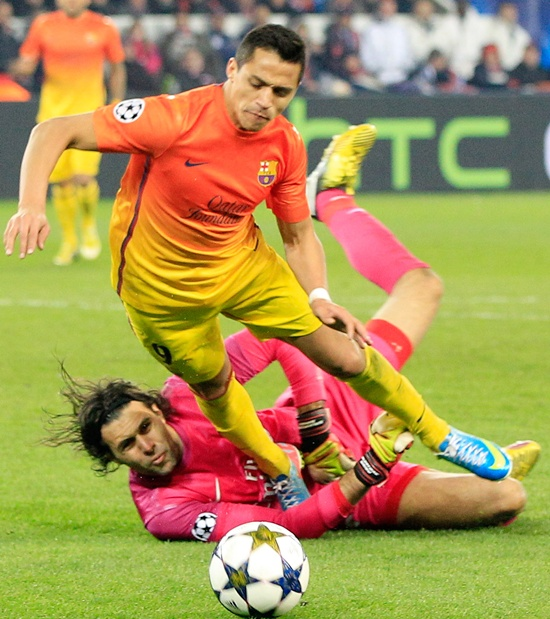 Paris St Germain's goalkeeper Salvatore Sirigu provokes the penalty against Barcelona's Alexis Sanchez