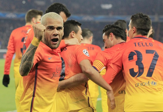 Barcelona's Daniel Alves (left) reacts after teammate Xavi Hernandez scored a penalty