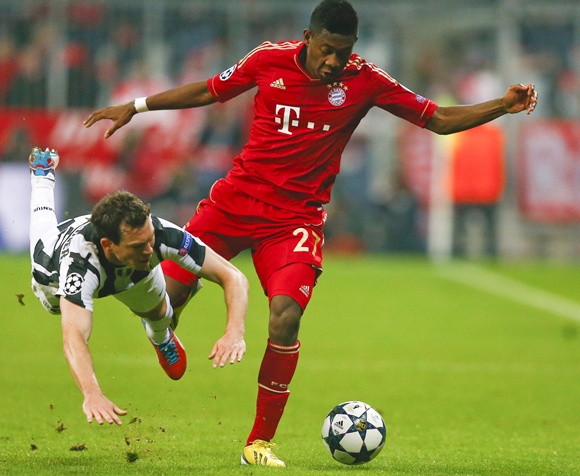 Juventus' Stephan Lichtsteiner (left) fights for the ball with Bayern Munich's David Alaba