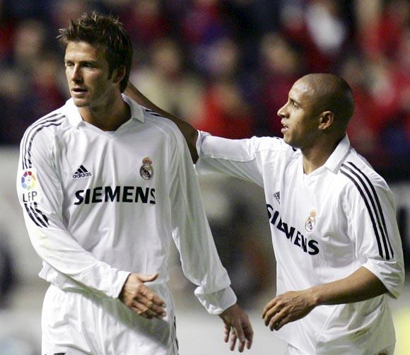 David Beckham with Roberto Carlos