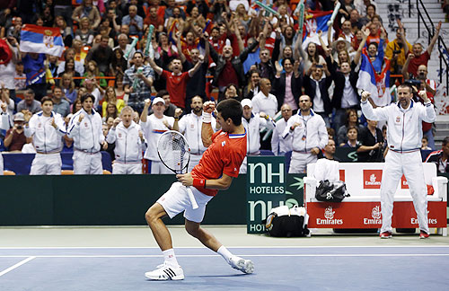 Serbia's Novak Djokovic reacts after defeating John Isner of the U.S. during their Davis Cup quarter-final tennis match in Boise, Idaho, on Friday